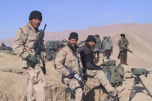 Vigil (left) with members of his team and members of the Northern Alliance west of Konduz Afghanistan in late 2001.""