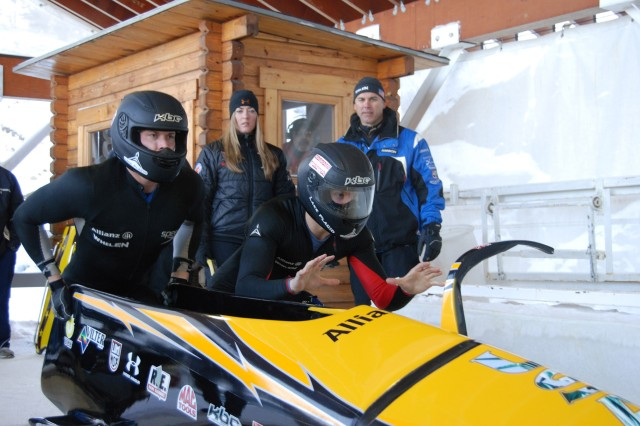 U.S. Army World Class Athlete Program bobsledder Pfc. John Napier (right) and Cory Butner (left) get set to push off during one of four heats in the Two-man U.S. National Bobsled Championships in Lake Placid, N.Y. The duo earned a spot in the 2009 World Championships, scheduled for Feb. 20-March 1 in Lake Placid, with a four-heat cumulative winning time of 3 minutes, 45.87 seconds.