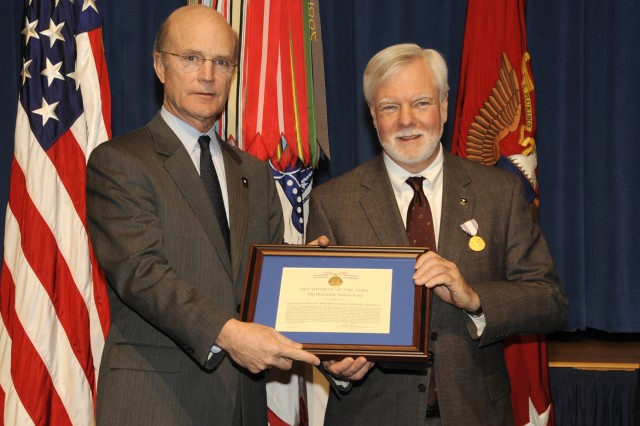 The Honorable Under Secretary of the Army Nelson Ford receives the Distinguished Civilian Service Award from the Honorable Secretary of the Army Pete Geren in a farewell cereony honoring Nelson Ford in the auditorium at the Pentagon on January 5, 2009.