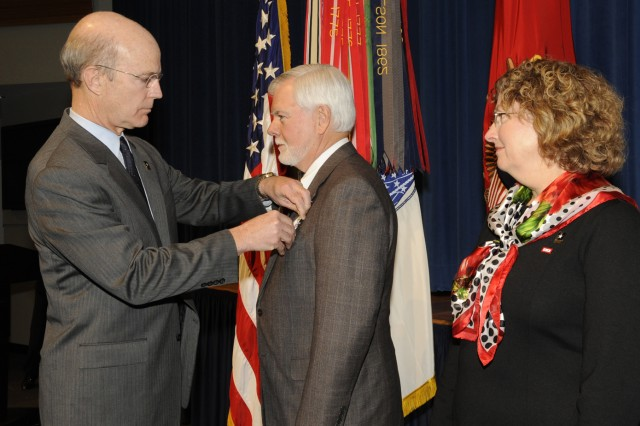 The Honorable Under Secretary of the Army Nelson Ford receives the Distinguished Civilian Service Award from the Honorable Secretary of the Army Pete Geren in a farewell ceremony honoring Nelson Ford in the auditorium at the Pentagon on January 5, 2009.