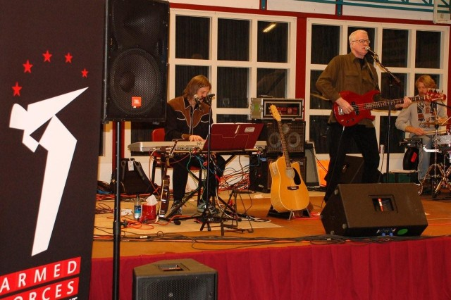 """USAG Schinnen, NETHERLANDS – First Class performers. Todd Cerney, on keyboards; Bob Regan  on the bass; and John Root on drums  perform with Thom Shepherd and the Nashville Songwriters Band to service and family members assigned to the Tri-Border region of Germany, Belgium and the Netherlands Jan. 7, 2009. Armed Forces Entertainment (AFE) is a U.S. Department of Defense (DoD) agency that provides entertainment to U.S. military personnel overseas. They host over 1,200 shows around the world annually to over 500,000 personnel. Talent includes musicians, comedians, cheerleaders, and celebrities of sports, movies and television and, in this case, a band of songwriters who've written for some of Country and Western Music's biggest stars. Todd Cerney was a Grammy nominee in the Best Country Song category for """"I'll Still Be Loving You"""" recorded by Restless Heart and won the ASCAP Country Song of the Year for the same song in 1987. John Root is a percussion expert with a resume reaching from Hank Williams III to Tammy Cochran to Thom Shepherd. (USAG Schinnen Army Public Affairs)"""