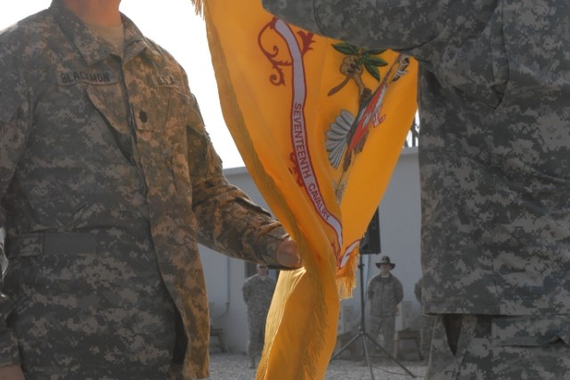 Lt. Col. Jimmy Blackmon, 7th Squadron, 17th Cavalry Regiment, 159th Combat Aviation Brigade, 101st Airborne Division commander, and 7-17 the Command Sergeant Major, Eric Thom, uncase the battalion colors during a transfer-of-authority ceremony Jan. 06. (U.S. Army photo by Sgt. Charles Brice)