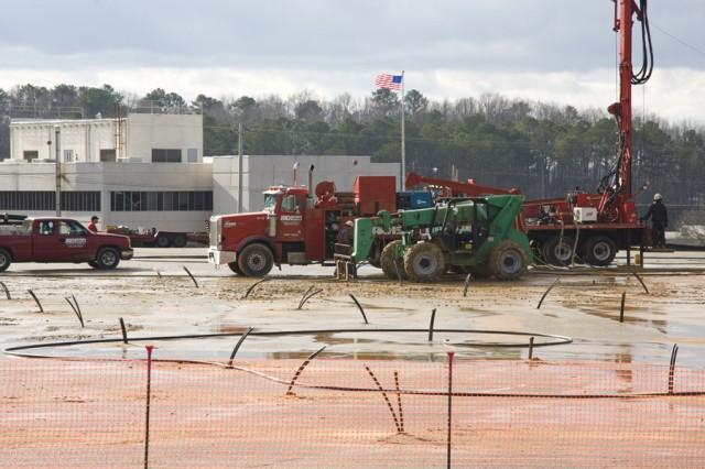 Contractors drill the upper parking lot near Anniston Army Depot, Ala., headquarters building on Jan. 7 for the installation of a Ground Coupled Heat Pump system. The GCHP will save more energy compared to the current heating and cooling system there.