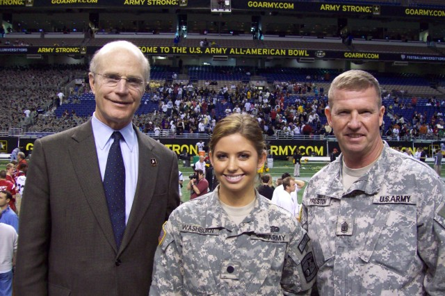 Army ROTC Cadet Rachel Washburn, a Junior at Drexel University and a Philadelphia Eagles Cheerleader, participated in events at the U.S. Army All-American Bowl Jan.3 in San Antonio, Texas. Pictured with Secretary of the Army Pete Geren (left) and Sgt. Maj. of the Army Kenneth O. Preston.
