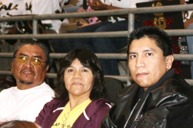 """Spc. Lawrence Guerro (right) enjoys the U.S. Army All American Bowl Jan. 3 at the Alamodome with parents Larry and Marie Guerro. """"The event like today gives me an opportunity to spend time with my son...,"""" said Marie Guerro."""