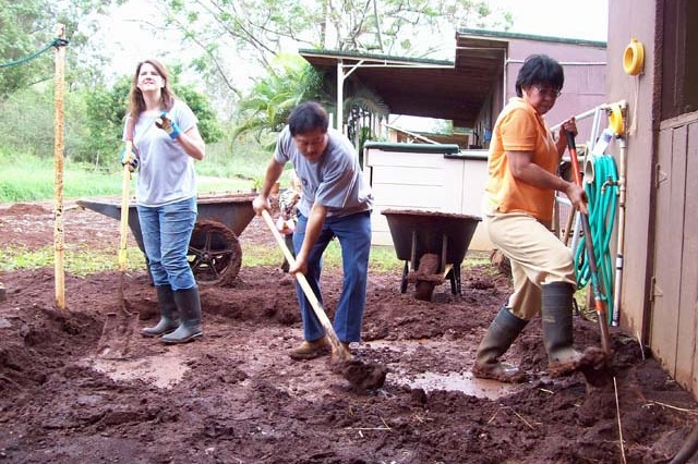 <p>WHEELER ARMY AIRFIELD, Hawaii — Volunteers work to clear mud at the Wheeler Saddle Club on Wheeler Army Airfield, Dec. 12, 2008. During the four-day rainstorm, which began Dec. 10, the road leading to the stables was covered with a 50-foot wide river with a 30-foot tall waterfall.</p><p>Editor's Note: This photo was run in conjunction with a 2008 Year in Review article in the <i>Hawaii Army Weekly</i>, U.S. Army Garrison-Hawaii's post newspaper.)</p>