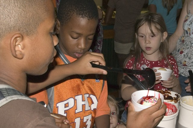 <p>SCHOFIELD BARRACKS, Hawaii - Joshua Mason, Terric Bennett and Katherine Gootee line up for a sundae treat during Family Fun Fridays kick-off event. Numerous military families gathered together for games, prizes and food specials, enjoying a night out at the Tropics Recreation Center, Nov. 14, 2008.</p><p>(Editor's Note: This photo was run in conjunction with a 2008 Year in Review article in the <i>Hawaii Army Weekly</i>, U.S. Army Garrison-Hawaii's post newspaper.)</p>