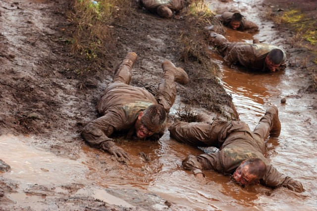 <p>SCHOFIELD BARRACKS, Hawaii - Members of the 1-27 Infantry Battalion, 2nd Stryker Brigade Combat Team perform a low crawl as part of their training regimen, Feb. 4, 2008.</p><p>(Editor's Note: This photo was run in conjunction with a 2008 Year in Review article in the <i>Hawaii Army Weekly</i>, U.S. Army Garrison-Hawaii's post newspaper.)</p>