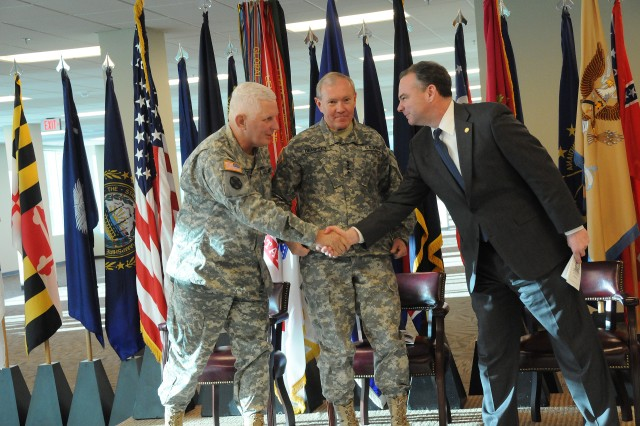 Maj. Gen. James E. Chambers, Combined Arms Support Command and Fort Lee commanding general, shakes hands with Virginia Gov. Timothy Kaine while Gen. Martin E. Dempsey, commander, Tranining and Doctrine Command, looks on.  The three spoke during the ribbon-cutting ceremony for CASCOM's Sustainment Center of Excellence headquarters building held Friday, Jan. 9 at Fort Lee, Va.