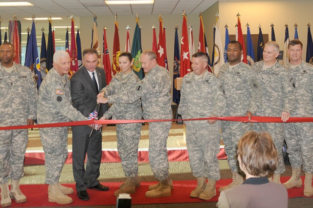 Maj. Gen. James E. Chambers, Combined Arms Support Command and Fort Lee commanding general; Virginia Gov. Timothy M. Kaine; Pfc. Maria Morganstern, the youngest Soldier on Fort Lee, representing the future of the Logistics Corps; and Gen. Martin E. Dempsey, Training and Doctrine Command commanding general, cut the ribbon for the Sustainment Center of Excellence headquarters building at Fort Lee during a ceremony Jan. 9.  The $50 million structure will serve as the headquarters for the CASCOM and its subordinate commands.