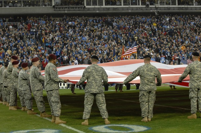 Nashville, TN - Soldiers of the 101st Airborne Division (Air Assault) unfurl the Nation's flag during the half time show between the Tennessee Titans and the Baltimore Ravens Jan. 10, 2009. Many of the Soldiers have just returned from combat in Iraq and Afghanistan. The half time show paid tribute the all the armed forces. Official Army photo by: Jerry Woller