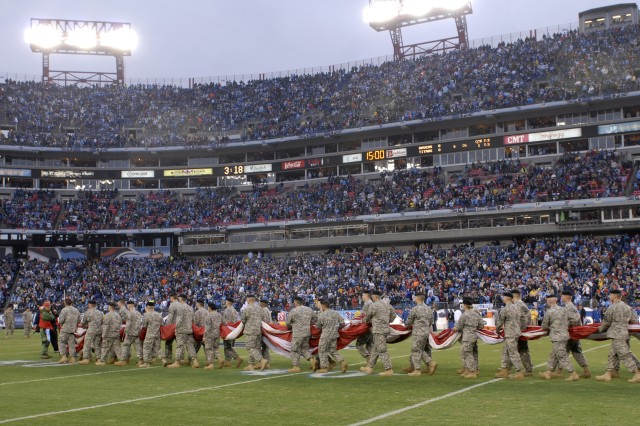 Fort Campbell Soldiers carry the U.S. Flag onto the field before the Jan. 10, 2009 NFL Regional Playoff game between the Tennessee Titans and the Baltimore Ravens. Fort Campbell has long had an outstanding relationship with the Titans, and Fort Campbell Soldiers are frequently honored during home games.