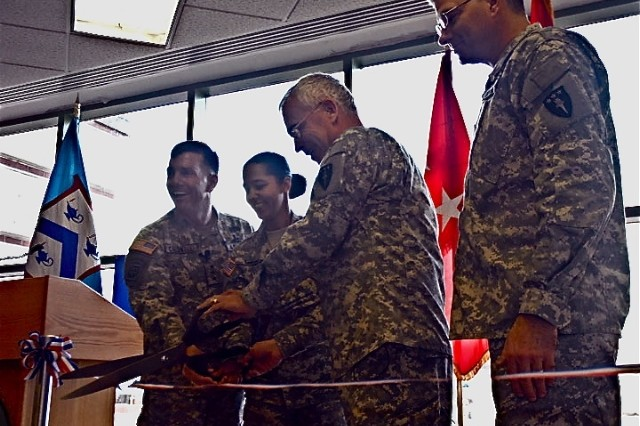 Lt. Gen. William Caldwell IV, commander of the Combined Arms Center and Fort Leavenworth; Lt. Col. Georgette Diggs, deputy director, CGSC APFRI annex; Maj. Gen. Robert Williams, commandant Army War College and Col. Tom Williams, director APFRI Army War College, cut the ribbon opening the new APFRI annex at the Command and General Staff College.