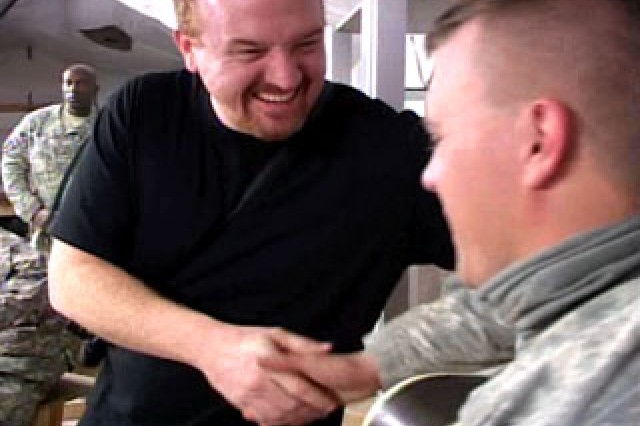 Comedian Louis CK mingles with Soldiers in the Middle East.