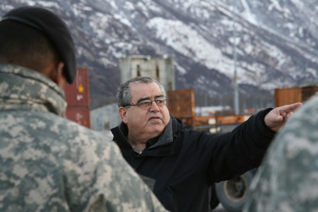 While waiting for a barge carrying military cargo, Bob Meno, chief of the Alaska Detachment, explains the Port of Valdez to members of the 1394th Transportation Group from San Diego, Calif., Nov. 4.