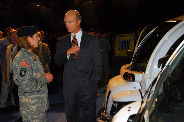 "Secretary of the Army Pete Geren and Col. Laura Richardson, Fort Myer installation commander, speak Jan. 12 following the ceremonial delivery of six ""neighborhood electric vehicles"" to the Army. The delivery of the NEVs, which are entirely electric powered, represents the beginning of a leasing action by the Army to obtain more than 4,000 of the vehicles. The use of NEVs by the Army is part of its comprehensive and far-reaching energy security initiative to ease its dependence on fossil fuels. As part of that initiative, the service will be leveraging electric vehicles and other technologies that exist today, as well as exploring emerging technologies."