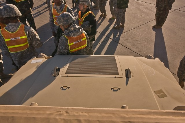 Soldiers from the 1st Air Cavalry Brigade, 1st Cavalry Division, conduct a safety briefing at the head of the vehicle lineup before they load the heavy equipment onto rail cars at the railhead in Fort Hood, Texas, for movement to Fort Irwin, Calif., Jan. 6.