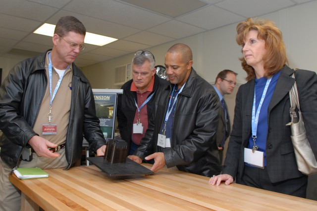 From left, Col. Dan Mitchell, Red River Army Depot commander, Ted Sturgeon, DAELP program director, Sgt. Maj. Tony Butler, Anniston Army Depot, and Teresa Weaver, RRAD Resource Management Directorate, tour depot work areas Dec. 18.  Members of the 2008-2009 DAELP class participated in the on-site visit as part of an AMC executive development program.