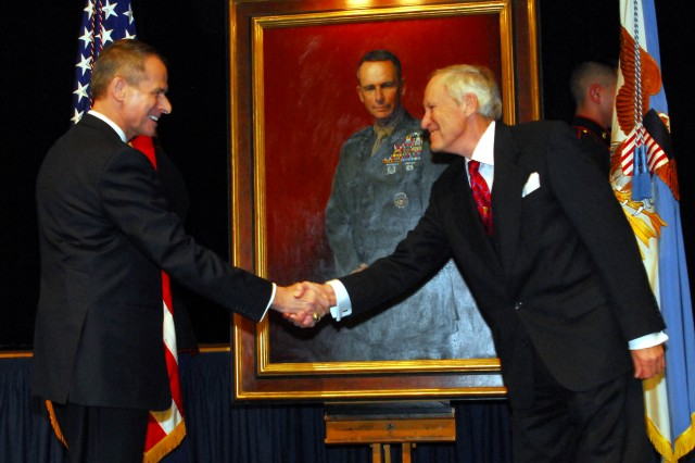 Former chairman of the Joint Chiefs of Staff, retired Marine Corps Gen. Peter Pace greets portrait artist Peter E. Egeli following the unveiling of Pace's portrait.  The portrait was unveiled Jan. 13 during a ceremony at the Pentagon.  The painting will be displayed in a corridor of the Pentagon along with portraits of other former chairmen.