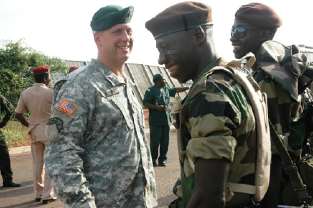 BAMAKO, Mali - Lt. Col. Jay Conners, commander of the forward deployed element of the Joint Special Operations Task Force (Trans-Sahara), greets Senegalese soldiers who recently arrived in Bamako, Mali to participate in FLINTLOCK on Nov. 3, 2008. The three-day exercise, which includes participation of key European nations, is designed to build relationships and capacity among security forces throughout the Trans-Saharan region of Africa and is the first exercise for USAFRICOM since its creation on Oct. 1, 2008.