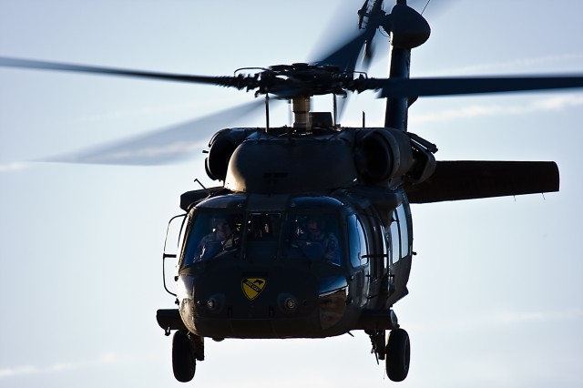 """A UH-60 Black Hawk from the 3rd Assault Helicopter Battalion, 227th Aviation Regiment, 1st Air Cavalry Brigade, 1st Cavalry Division, departs Robert Gray Army Airfield, Fort Hood, Texas, Jan. 8. """"Spearhead"""" will be supporting 1st Attack Reconnaissance Battalion, 227th Aviation Regiment, 1st ACB, 1st Cav., Div., at Fort Irwin, Calif., for a month-long rotation at the National Training Center."""
