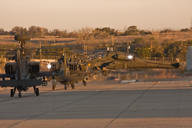 Four AH-64D Apache attack helicopters from 1st Attack Reconnaissance Battalion, 227th Aviation Regiment, 1st Air Cavalry Brigade, 1st Cavalry Division, stand by to launch from Robert Gray Army Airfield, Fort Hood, Texas, Jan 8. The aircraft will be flying to Fort Irwin, Calif., for a month-long rotation at the National Training Center.