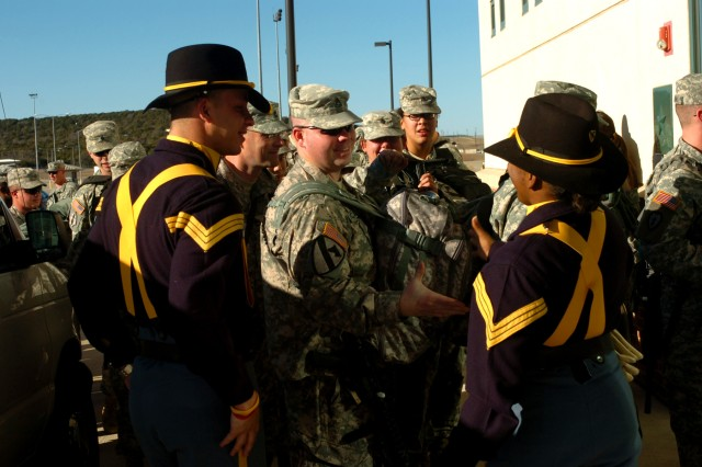 Soldiers from the 2nd Brigade Combat Team, 1st Cavalry Division receive congratulatory handshakes and words of encouragement Jan. 8 at Fort Hood, Texas from members of the 1st Cavalry Division Honor Guard, before flying to the sands of Iraq for a year deployment in support of Operation Iraqi Freedom 08-10.