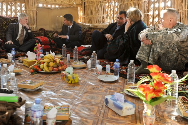U.S. Ambassador to Iraq Ryan Crocker speaks with a local leader in the Muthanna Province as Col. Philip Battaglia, commander of the 4th BCT, 1st Cav. Div. and other State Department officials listen Jan. 10.