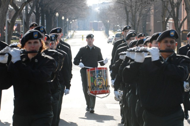 Staff Sgt. Brian L. Barnhart, a snare drummer with the 3rd U.S. Infantry Regiment's Fife and Drum Corps, trails the ensemble down Sheridan Avenue on Fort Myer, Va., during a Jan. 9, rehearsal for President-elect Barack Obama's inaugural parade.