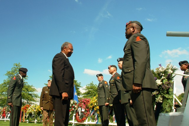 Army veteran Conrad Payne (center), USAG Schinnen Retiree Council president, presents a wreath at the Netherlands American Cemetery and Memorial May 25, 2008.