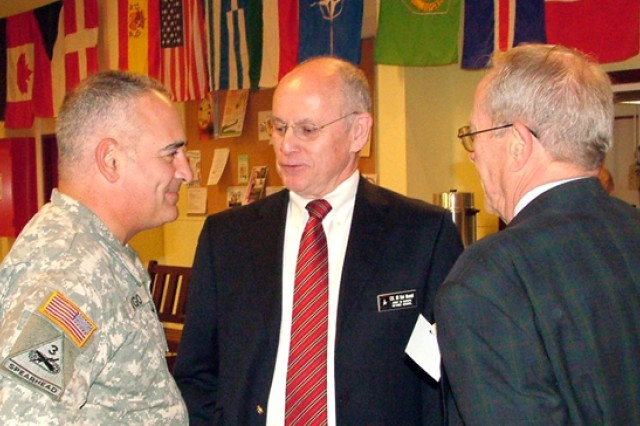 U.S. Army Garrison Benelux Commander Col. James P. Drago welcomes U.S. Army Europe Retiree Council President Bob Mentell (center), a retired Army colonel, and USAG Benelux Retiree Council President Charles Westpheling to Retirement Appreciation Day Oct 18, 2008.