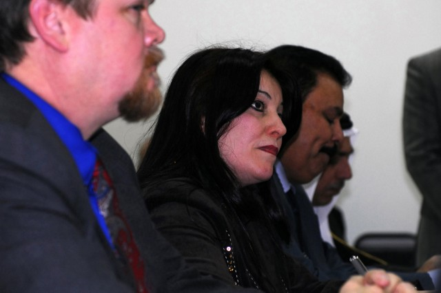 (left to right) Howard Keegan, the Provincial Reconstruction Team leader, Silvana Bouya, the Assyrian member of the Kirkuk Provincial Council and Mohammed Khalil, one of the Arab members of the Kirkuk Provincial Council, listen as Sen. Joe Biden, D-Del., U.S. vice president-elect, Chairman of the Senate Foreign Relations Committee speaks during his visit at Forward Operating Base Warrior to meet with local Kirkuk Provincial officials, Jan. 13. (U.S. Army photo by Spc. Karla P. Elliott, 11th Public Affairs Detachment.)