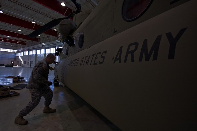 Spc. Duane Topping of Denver, a Soldier in Company D, 2nd General Support Aviation Battalion, 227th Aviation Regiment, 1st Air Cavalry Brigade, 1st Cavalry Division, starts to reinstall aircraft panels as he completes his portion of a 180-day corrosion control inspection on a CH-47F Chinook, at Hood Army Airfield, Fort Hood, Texas, Jan. 14.