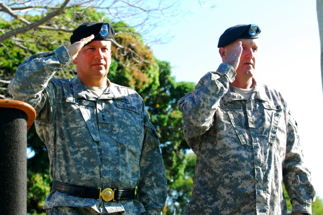 MG Raymond V. Mason, Commanding General, 8th TSC, and Col. Clay Hatcher, Commander, 45th Sustainment Brigade, salute the National Colors during the National Anthem at the 45th Sus. Bde. deployment ceremony, Jan. 9 at Hamilton Field, Schofield Barracks, Hawaii.