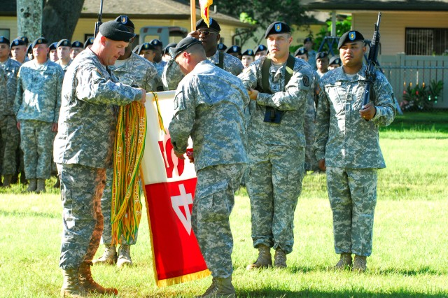 Col. Clay Hatcher, Commander, 45th Sus. Bde., left, and Command Sgt. Maj. Benjamin Ramos, case the brigade colors during the 45th Sus. Bde. deployment ceremony, Jan. 9 on Hamilton Field, Schofield Barracks, Hawaii.