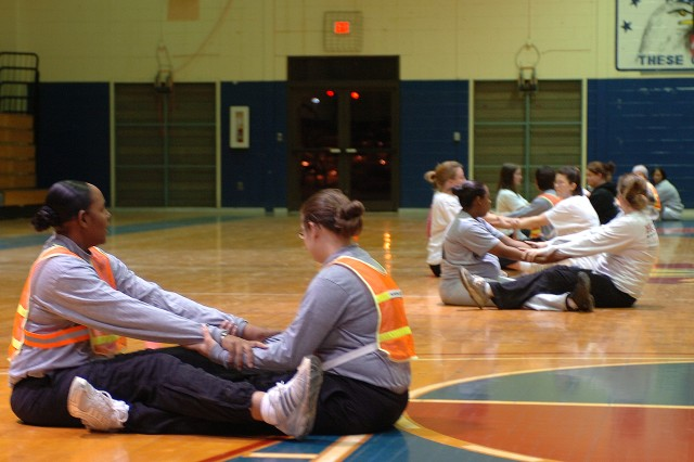 Soldiers with the 13th Sustainment Command (Expeditionary) conduct streching exercises Jan. 12 at the Kieschnick Physical Fitness Center as a part of the command's Pregnancy/Postpartum Physical Training program.