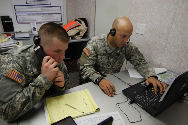 Pfc. Ryan Chinnock (left), a forward observer with Company D, 1st Battalion, 325th Airborne Infantry Regiment, 2nd Brigade Combat Team, 82nd Airborne Division, and  his platoon leader, 1st Lt. Chad Taylor, call in an airstrike during the 2nd BCT's Virtual Joint Fire Coordination Exercise held at the Battle Command Training Center Jan. 12 - 15.