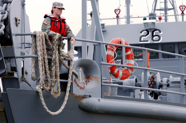 Spc. Francis Bickle, assigned to the 824th Transportation Company (Heavy Boat), prepares to throw a line from the U.S. Army Reserve Landing Craft Utility Vessel Matamoros to Soldiers on land after a short two-day training exercise off the coast of Morehead City, N.C. The Matamoros is one of the Army Reserve's largest movers and can move five M1 Abrams Main Battle Tanks on its deck. Used primarily near the coast, the crew of 13 Soldiers spent the weekend training off the Outer Banks of North Carolina during battle assembly on Feb. 10 and 11. The 824th is assigned to the 143rd Expeditionary Sustainment Command out of Orlando, Fla.