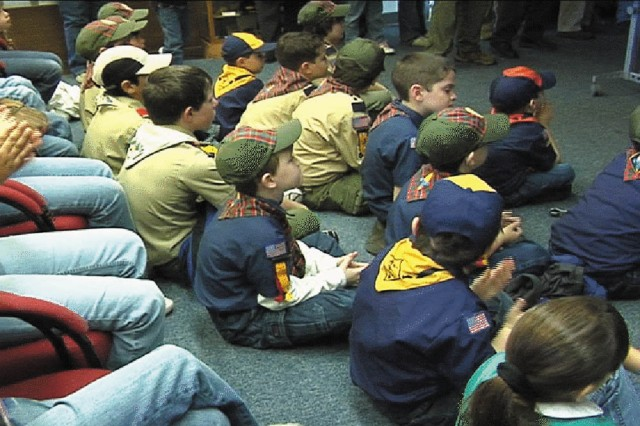FORT GORDON, Ga. (January 15, 2009) During a video teleconference in Signal Towers at Fort Gordon on Jan. 10, Cub Scouts, Webelo Scouts, Girl Scouts and their leaders view a split screen and converse with  scouts in Iraq. Photo by Ken James