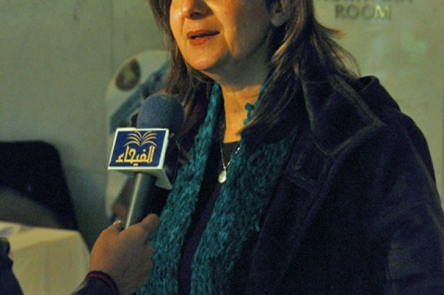 Mary Terese D. Marrow, owner of Melik Al Misk for Trading and General Contracts Ltd., responds to questions for Al Fayhaa Television Jan. 12 at the Al Rasheed Hotel in BaghdadAca,!a,,cs International Zone.