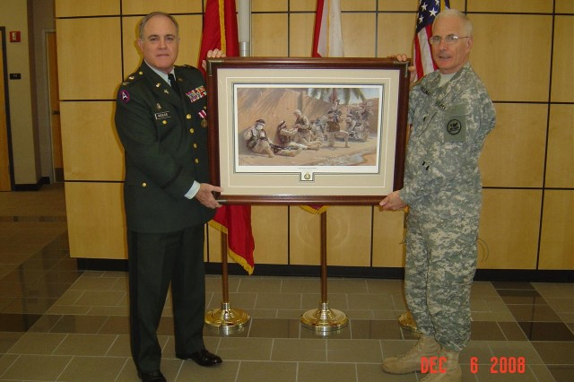 """Alabama National Guard Col. James Reece, left, receives a gift of the popular print """"They Were Always There"""" from Col. Roy Hallmark upon his retirement as the Guard's state chaplain in December. Hallmark is now serving as the National Guard's state chaplain. The print is a copy of an original Iraqi battlefield scene painted by retired Chaplain (Col.) Larry Selman that hangs in the Pentagon office of the chief of chaplains."""