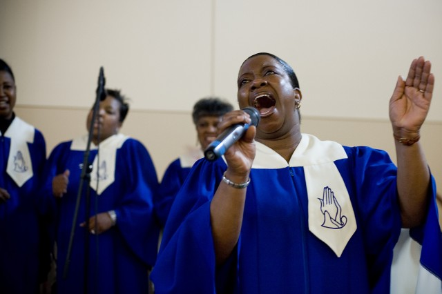 Grace Gospel Church choir song leader Mary Linquist sings during a service Jan 11 at the North Fort Lewis Chapel.