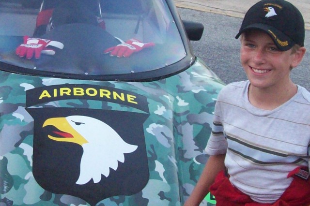 12-year-old Travis Benson poses for photographs after an Aug. 2, 2008 win at Houston MotorSports Park. Benson drives the 101st Airborne Division (Air Assault) themed Bandolero car in honor of his Grandfather Rondal Bensons. His grandfather served as a Screaming Eagle from 1958 to 1959.