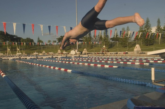 WAIPIO, Hawaii - Trey George dives into the pool at the Central Oahu Regional Park during swim practice. George joined the Aloha Aquatics swim team in August, two years after his open-heart surgery.