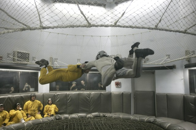 NASCAR driver Ryan Newman (yellow uniform) in the free fall wind tunnel at Fort Bragg, N.C.