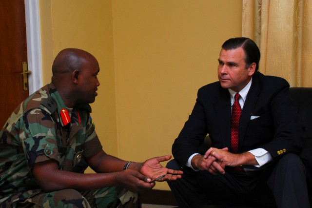 NYAKINAMA, Rwanda - Colonel Aloy Muganga, Commandant of Rwandan Military Academy, meets with W. Stuart Symington, U.S. Ambassador to Rwanda, January 8, 2009, in Nyakinama. During his visit to the academy, Symington delivered approximately 500 books, which were donated by the U.S. Air Force, to improve the technical knowledge and English-language reading ability of soldiers in the Rwanda Defence Force.