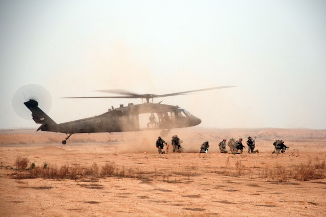 A Pathfinder team from Fox Company, 2nd Battalion, 10th Combat Aviation Brigade secures the landing zone while a UH-60 Blackhawk touches down to recover the Soldiers Dec. 23. The unit conducted air-assaulted traffic-control point training in the days leading up to Operation Blackhawk Pickett, a counter-smuggling operation Dec. 26 - Jan. 10 that utilized the Pathfinders' unique combination of Infantry and Aviation assets.