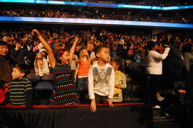 """Thousands of children from military families around the National Capitol Region gathered Jan. 19 at the Verizon Center, in the heart of the nation's capital, to attend the """"We Are the Future"""" concert, hosted by Michelle Obama, wife of President-elect Barack Obama. The concert featured performances by Miley Cyrus, the Jonas Brothers, Bow Wow, Demi Lovato and Corbin Blue. Country musician Billy Ray Cyrus appeared on stage and performed with daughter Miley. Keke Palmer and Usher Raymond IV also made appearances, as did comedian and actor George Lopez. Both Michelle Obama and Dr. Jill Biden, wife of Vice President-elect Joe Biden, made speeches during the event.  The event was one of many surrounding the Jan. 20 inauguration of President-elect Barack Obama."""