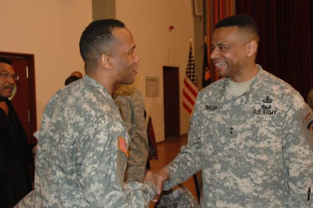 Maj. Gen. Byron S. Bagby greets Master Sgt. Luvert Hollis after the Martin Luther King Jr. Breakfast Celebration in Heidelberg Jan. 15.