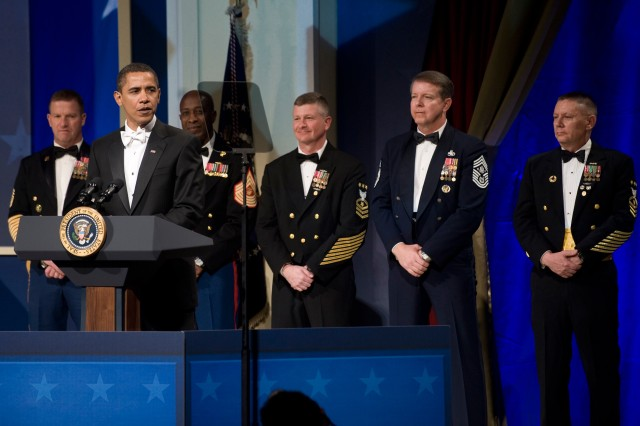 Surrounded by each service's senior enlisted advisor, President Barack Obama addresses the audience at the Commander-in-Chief's Ball at the National Building Museum in Washington, D.C., Jan. 20, 2009. The ball honored America's servicemembers, families, the fallen and wounded warriors.